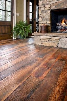 Southern Accents in Cullman, AL has old barn wood and makes this flooring! I like the flooring, fireplace and doors Old Barn Wood, Log Homes, Barn Homes, My Dream Home, Future House, Home Remodeling, Beautiful Homes, Home Improvement, Sweet Home