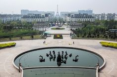 Pictured, on the outskirts of Hangzhou, copies of Parisian townhouses, complete with Eiffel Tower