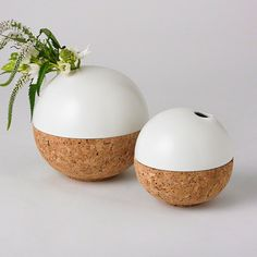 Amusing ceramic sphere vases sit inside a cork base to achieve an unexpected mix of textures and materials. Available in two sizes.