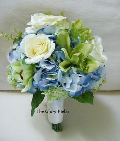 Blue Hydrangea, Green Cym Orchids, Ivory Roses and Green Viburnum Silk Wedding Bouquet. Custom Wedding Packages Available! by TheGloryFields on Etsy https://www.etsy.com/listing/212561664/blue-hydrangea-green-cym-orchids-ivory