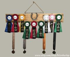 Display your hard-earned ribbons in your home or at the barn… OR take this unique wooden display rack with you to your event and add your ribbon display to your stall door! This simple, lightweight design makes this piece portable, yet easy to secure to a stall door, window, horse