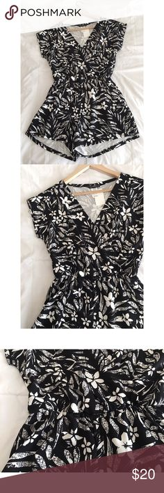🆕NWT Floral Deep V neck Romper black and white New with tag! Super cute floral romper. In black and white. Deep V-neck. Cinched waist. Flattering fit. Super comfy and airy!  Size Medium  NWT Pants Jumpsuits & Rompers