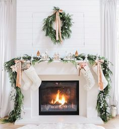 picture-of-evergreen-garland-and-wreath-bows-and-small-houses-make-the-fireplace-very-cozy