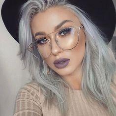 She is wearing our Born This Way Foundation and Melted Matte Liquified Lipstick in shade Granny Panties.