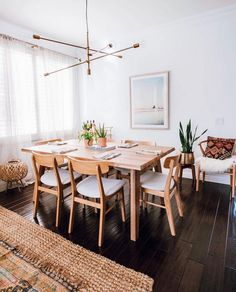 Modern Scandinavian Dining Room with a eclectic and boho vibe! This dining room features an oak dining table, brass lighting, and a vintage rug for a casual comfortable entertaining space. Oak Dining Chairs, Modern Dining Table, Dining Set, Room Chairs, Mid Century Dining Chairs, Outdoor Dining, Light Oak Dining Table, Warm Dining Room, Modern Dining Room Lighting