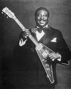 Albert King posing with a Gibson Flying V