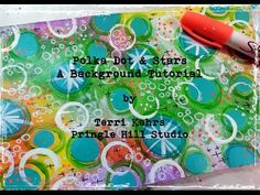 A layered, polka dot art journal background created with acrylic paints and various art mediums.