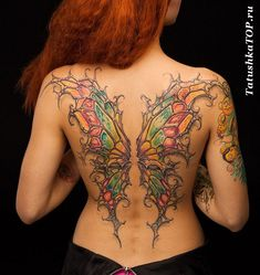 Lovely full back tattoo - butterfly wings as if made of stained glass!