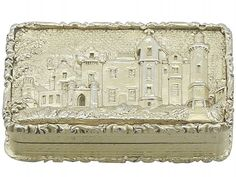 An exceptional, fine and impressive antique Victorian English sterling silver gilt castle top vinaigrette depicting Abbotsford House; an addition to our collectable box collection