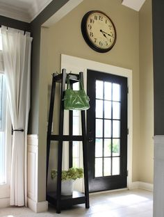Love the stand next to the door.  I'm looking through the blog to see if they DIY'ed it, but haven't found anything yet.  Do-able, though, and you can do lots with it!  Love the hooks at the top