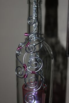 Clear bottle with pink votive, the wire wrap on this one came out really nice, love the simpleness of the pain bottle.