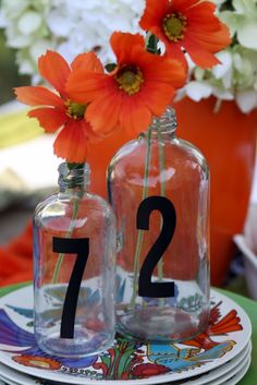 Table number idea: vinyl number decals on clear glass vases.