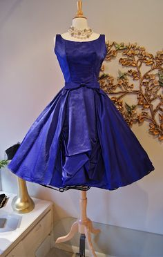 I may cry! Oh how I love this blue dress - the intensely-saturated hue and cinched in waist is to-die-for. Want it, need it.