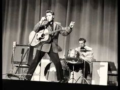 Here Horace Logan introduces at the Louisiana Hayride on Saturday, October 1, 1955 the fabulous Elvis Presley, Scotty Moore and Bill Black with their live ve...