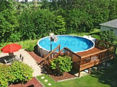 I really like the landscaping at the corners of the pool deck. Great example of a flow from patio to pool deck. Love the touch of a basketball goal too! Above Ground Swimming Pools, Swimming Pools Backyard, Swimming Pool Designs, In Ground Pools, Indoor Pools, Above Ground Pool Landscaping, Backyard Pool Landscaping, Landscaping Ideas, Acreage Landscaping