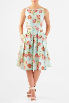 Washed florals amp up the sweet charm of our cotton dress, cut in a flattering fit-and-flare style and styled with an overlay skirt and center front vent that adds an instant flirt factor.