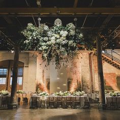 i'm a sucker for industrial / warehouse weddings • they're just so beautiful • happy thursday brides & bridesmaids! //  by @johnbenavente // anyone know who did the amazing hanging flowers?