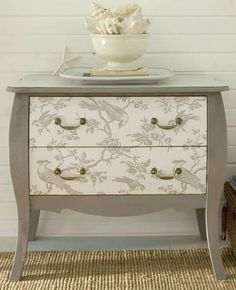 DIY  - Wallpaper your furniture!  Maybe to Mom's thing she gave me... paint the base, paper the drawers then varnish over it.