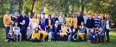 My wonderful LARGE family of 36 people. We coordinated our colors with: grey, blue, brown, white and gold / mustard yellow. Photo by http://www.taramerklerphotography.com/