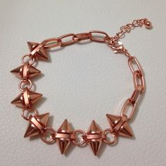 ASOS Double Spike + F21 Bracelets Rose gold.. Ask for bundle discount on jewelry. NEVER BEEN WORN but has a black mark on one of the side of spikes, see pic 3. Jewelry Bracelets