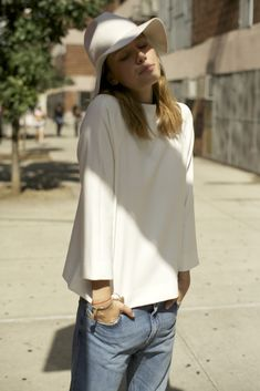 White structured shirt with vintage denim and white hat
