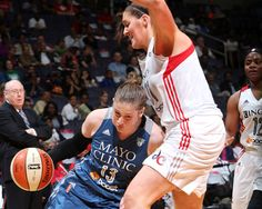 Minnesota's Lindsay Whalen tries to drive past Washington rookie Stephanie Dolan in the Lynx road win on Friday. (Photo by NBAE/Getty Images)