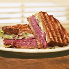 Cornbeef & cabbage grilled cheese. For leftovers http://www.dietzandwatson.com/recipes/sandwiches/beef/corned-beef-cabbage-sandwich/ I'm sure you can use any brand cornbeef and cheese to make this work.  Also, I'd definitely use rye bread. Yum! ;)