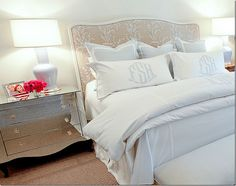 Bedroom decor ideas - Simple, white and grey colors, upholstered headboard and mirrored bedside table.