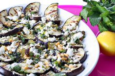 Grilled eggplant with creamy goat cheese and fresh herbs. This is a delicious way to serve eggplant.