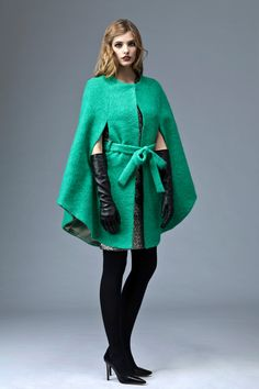 The spectacular silhouette of this vivid green mohair cape is not compromised by its comfort. The PLAKINGER AW 13-14 jade green cape is cut from a soft and textural mohair-wool blend and features a self-tie belt.