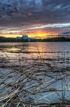 HDR photo of Töölönlahti bay by sunset with the Finnish National Opera and Olympic Stadium Tower in Helsinki, Finland.