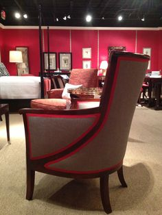 Grosgrain ribbon detail accentuates the gracious curves of Alexa Hampton's Breck chair.  It's perfect for open floor plans because it looks great from all angles! Hickory Chair (330 N. Hamilton St.) (www.hickorychair.com) #hpmkt #stylespotters