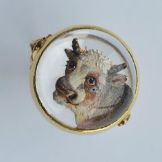 LOT 208: An Essex crystal ring in the form of a bull in carved gold mount with reeded decoration. Est. £800 - £1200. In our #Silver #Jewellery #Toys and #Railwayana #Auction on Thursday 25th May inclusive of  #Watches #Collectables #Pictures #China and #Antique #Furniture #May25#whittonsauctions #Honiton #pin