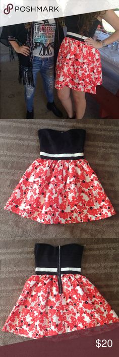 Flower print dress from Macy's It says it's 70% Polyester and 30% Spandex it's a really Heavy and Stretchy dress it's in good condition with only a couple loose strings around the zipper that were there when I got it Dresses Mini