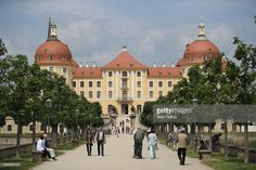 Visitors walk along the main path leading to Moritzburg Castle (Schloss Moritzburg) on May 26, 2016 in Moritzburg, Germany. Moritzburg Castle is a Baroque palace that was originally built as a hunting lodge in the 16th century for Moritz, Duke of Saxony. Today it is among Saxony's main tourist attractions.