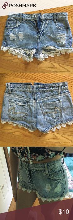 Light wash ripped denim high rise shorts Ripped denim high rise shorts with white  lace at the bottom Vanilla Star Shorts Jean Shorts