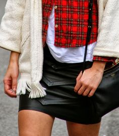 leather mini skirt with winter layers - white t-shirt, plaid button down, cozy fleece with fringe