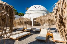 Kalithea Spring Therme Chairs on Beach with Pebbles and Bamboo Umbrella,Rhodes,Greece. Greece Travel, Rhodes, Opera House, Bamboo, Chairs, Spring, Building, Beach, The Beach