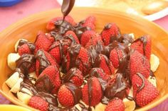 Salad with strawberries and bananas with melted dark chocolate