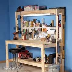 A workbench with a lower shelf and pegboard.
