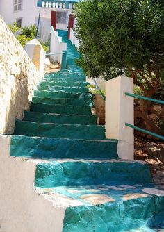 These deep blue and aqua steps on Hydra Island, Greece, give the effect of either climbing a waterfall or walking downstream.
