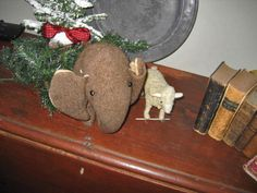 Early wool stuffed elephant and Steiff sheep on wheels