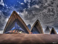 """""""Sydney Opera House HDR: On the the steps of the Opera House a girl plays a guitar, and I managed to get a shot with nobody else in the frame"""" by Flickr user Marc Emond"""