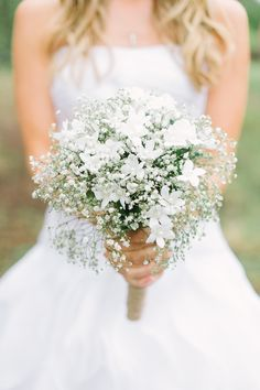 Love this simple bouquet - I'd add a little bit of whatever colors we're using the most in our wedding.