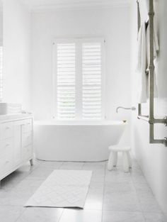 bathroom design - white bathroom with concret floor, free standing bath, and white shutters Modern White Bathroom, Modern Bathroom Design, Bathroom Interior Design, Beautiful Bathrooms, White Bathrooms, Bathroom Designs, Bathroom Black, Classic Bathroom, Luxury Bathrooms