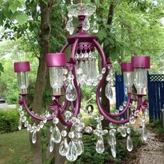 DIY solar powered repurposed chandelier.  How romantic for an outdoor wedding or party.  Replace the bulbs with dollar store solar outdoor lights.  Use any light fixture you like and decorate it any way you like.