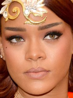 Close-up of Rihanna at the 2015 Met Ball. /paid homage to the Chinese theme (jet eyeliner, peaked cupid's bow, straight angled-up brows) without being, you know, offensive. also dig the blush swept all the way to the temples, which would look odd on most people who aren't Rhianna