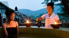 Natural hot water bath built 4 meters high, overlooking the river and jungle.  Muang La Resort, Northern Laos