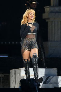 Rihanna Short Shorts Rihanna chose shorty shorts that featured embroidery all over for her on-stage look while performing in London. Rihanna Tunic Rihanna opted for a flowing sheer tunic to reveal her embroidered shorts while performing in concert.