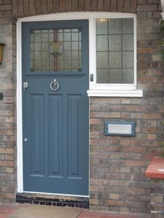 Front door color idea - slate blue front door colour - I like how it accents the red tones in the brick Front Door Paint Colors, Painted Front Doors, Front Door Design, Blue Front Doors, Front Door Porch, House Front Door, Glass Front Door, Brick Porch, Style At Home